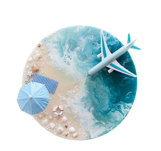 The concept of travel and air travel top view of the ocean shore umbrella shells and a landing plane