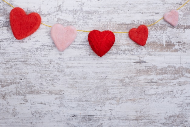 Concept of valentine's day. wicker hearts on wooden background