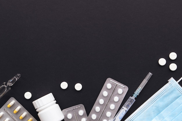 Concept of virus treatment, drugs on a black surface