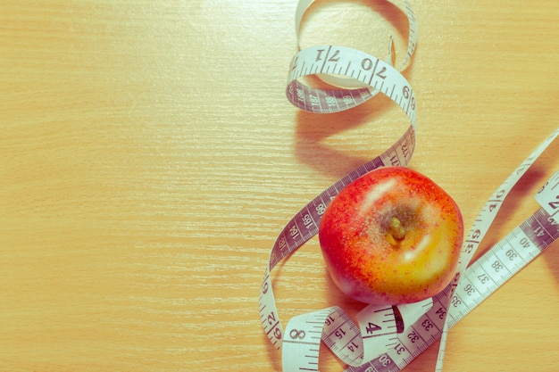 Concept of weight loss with fresh apple
