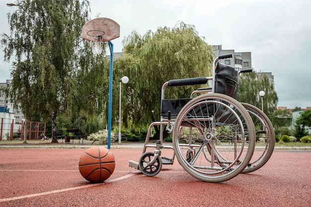 The concept of a wheelchair on the sports ground, a disabled person, a fulfilling life, paralyzed. wheelchair on the basketball court.