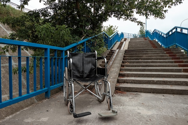 The concept of a wheelchair on the stairs turned over, disabled, full life, paralyzed. problems for the disabled person.