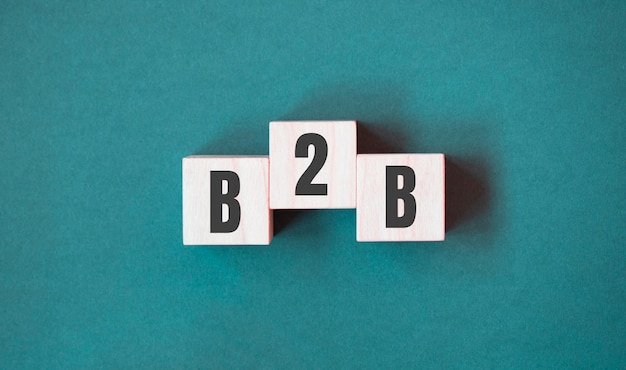Concept word b2b - business to business on cubes on a beautiful green background. business concept. copy space.