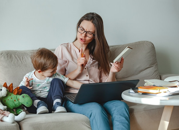 Concept work at home and home family education, mother swears