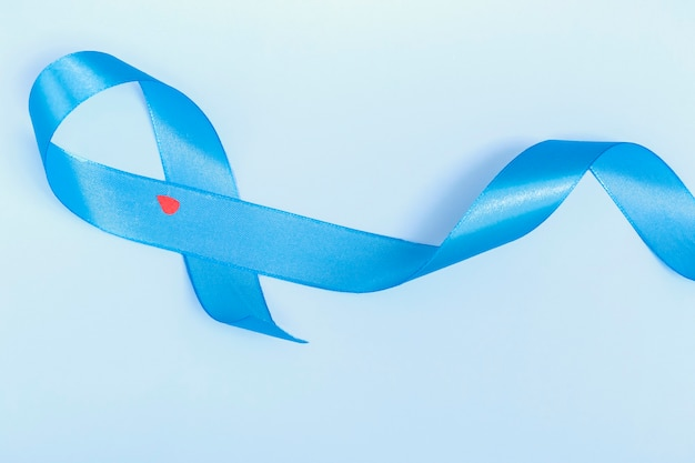 Concept for world diabetes day 14 november. symbolic bow color raising awareness on diabetes day on light background.