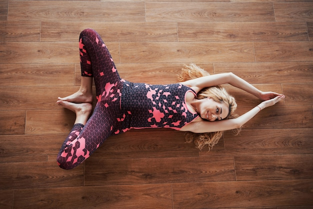 Concept of yoga and fitness pregnancy. portrait of a young model of a pregnant woman developing indoors.
