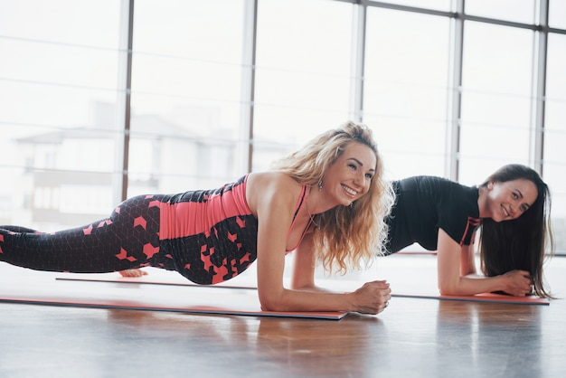 Concept of yoga and fitness pregnancy. portrait of a young model of pregnant yoga that is being developed indoors.