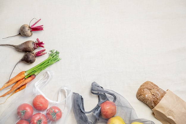 Concept of zero waste ethical shopping: raw vegan food in bio packaging flat lay