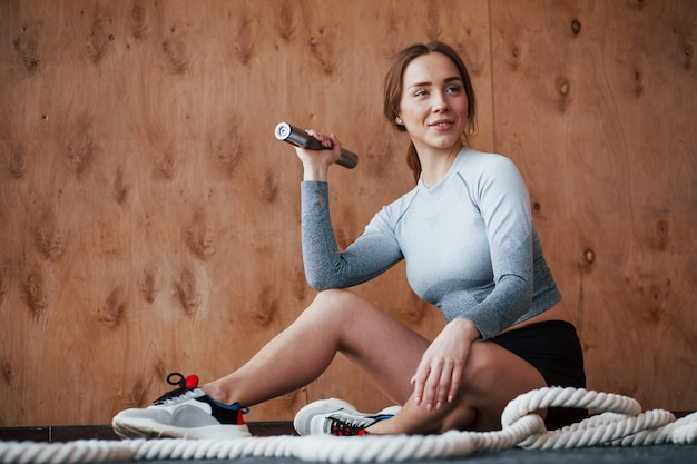 Conception of healthcare. sportive young woman have fitness day in the gym at morning time