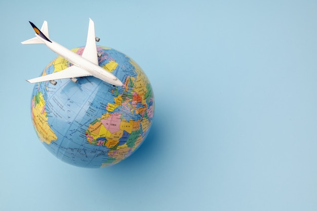 Conceptual airplane on earth globe