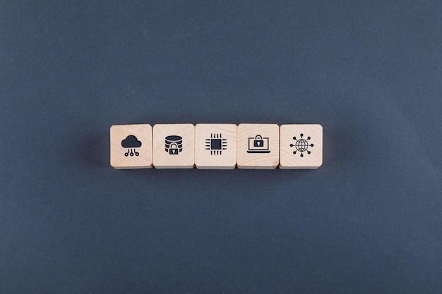 Conceptual of cloud server and business. with wooden blocks with icons on dark color table flat lay.