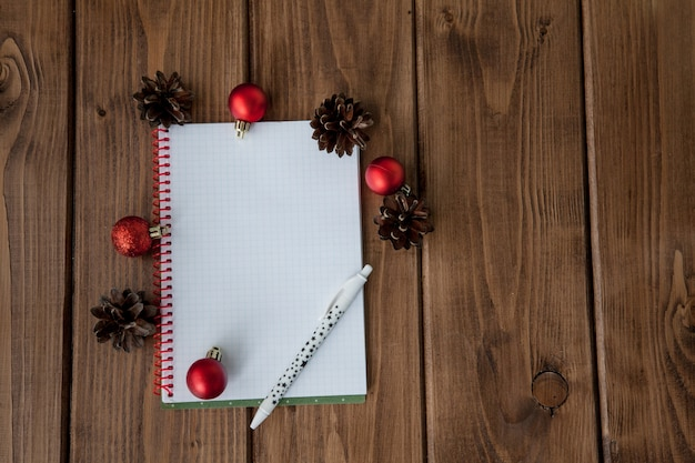 Conceptual composition on a wooden table with notebook with plans for the year