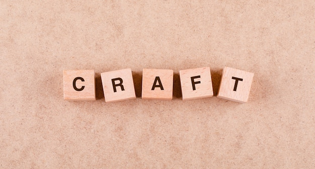 Conceptual of craft with wooden blocks with words  flat lay.