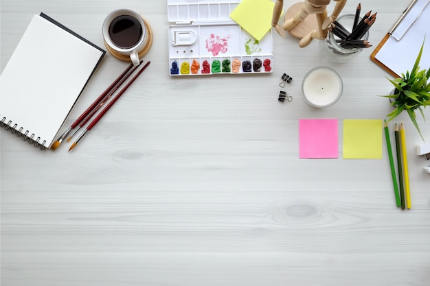 Conceptual image of artist graphic designer workplace white table. top view and copy space