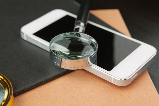 Conceptual image depicting conducting an online search for information with a magnifying glass