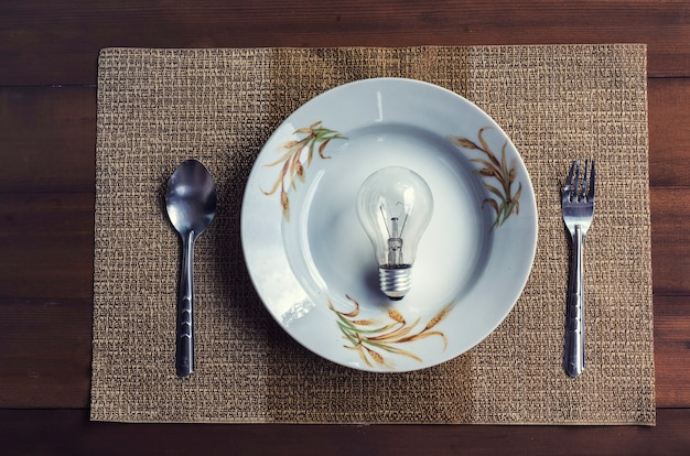 The conceptual image depicts the eating of ideas. and innovation with a dining set