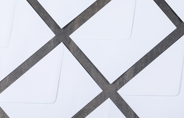 Conceptual of mail with white envelopes on gray background top view. horizontal image