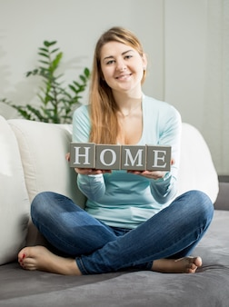 Conceptual photo of girl holding word