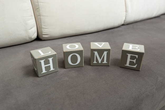 Conceptual photo of word home and love written on toy bricks