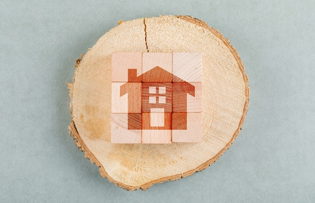 Conceptual of real estate with wooden blocks, wooden human figure top view.