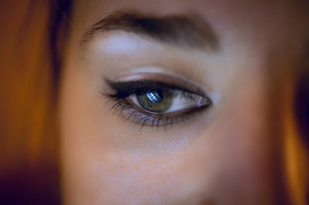 Conceptual shot of computer screen reflecting in woman eye