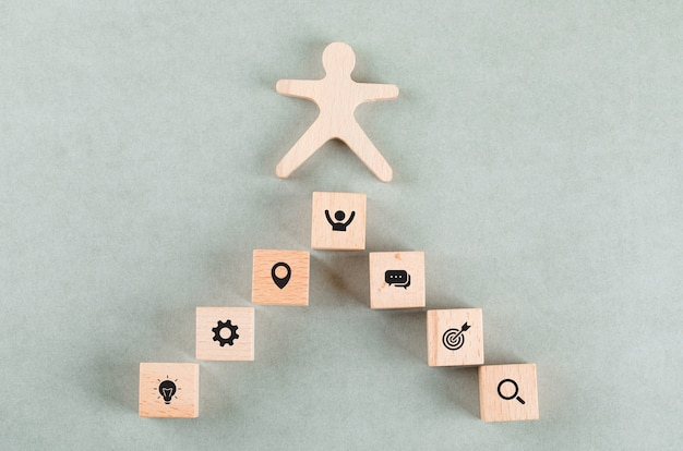 Conceptual of success business with wooden human, rectangle blocks.