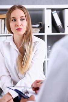 Concerned female visitor portrait talk with doctor