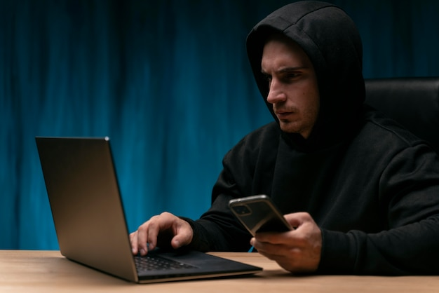 Concerned man with devices medium shot