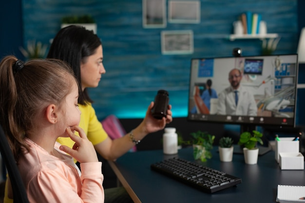 Concerned mother talking to doctor on video call