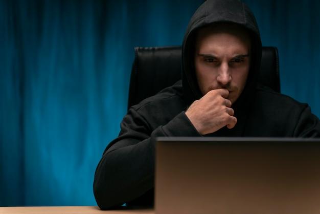 Concerned programmer with laptop medium shot