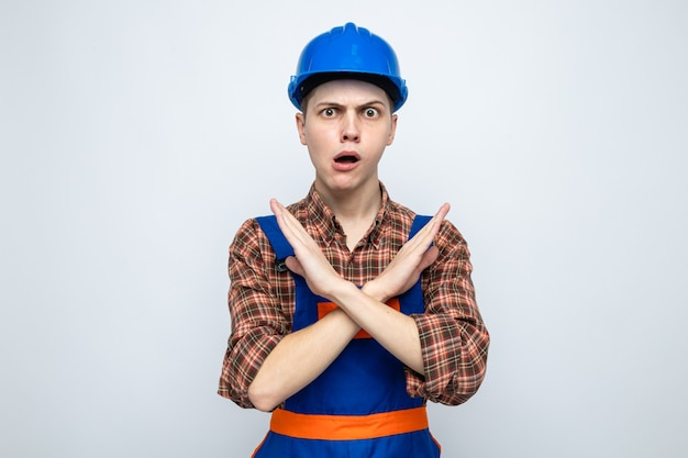 Concerned showing gesture of no young male builder wearing uniform