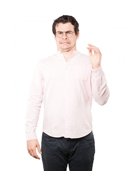 Concerned young man with a gesture of disgust