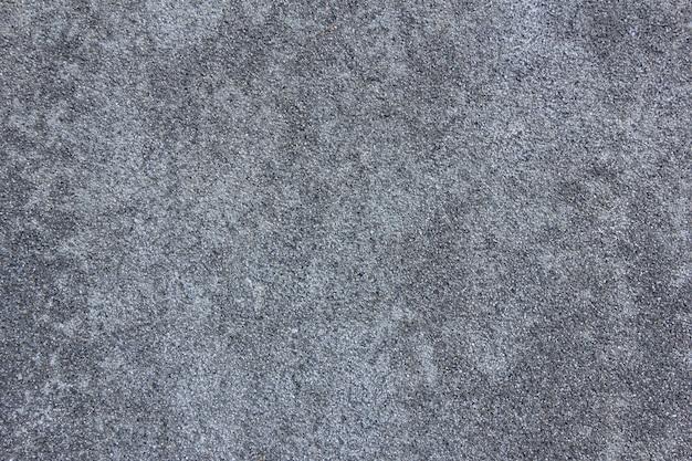 Бетонный фон. естественная темно-серая каменная текстура. стена с копией пространства.
