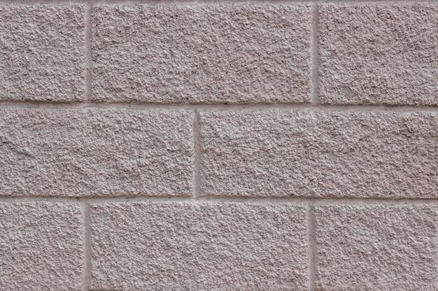 レンガを模倣した長方形のパターンとコンクリートの背景