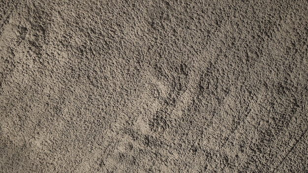 Concrete cement background and dirty rugged and jagged rough texture.