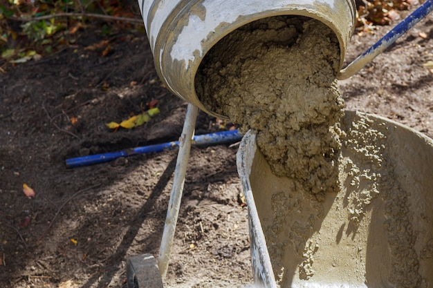 An concrete mixer poured the finished solution into a bucket
