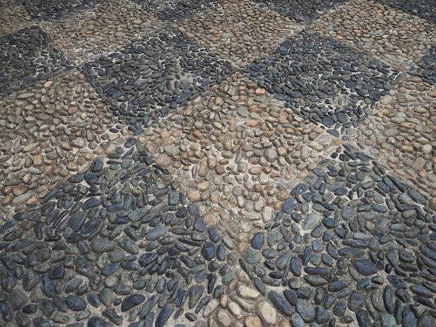 Concrete and pebble tiles floor