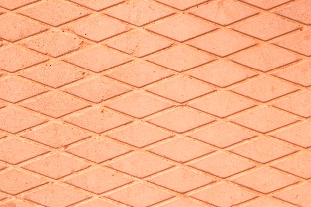 Concrete slab. drawing of diamonds. the texture of the concrete slab. gray background. pink, orange background