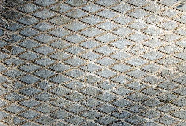Concrete slab. drawing of diamonds. the texture of the concrete slab. gray background.