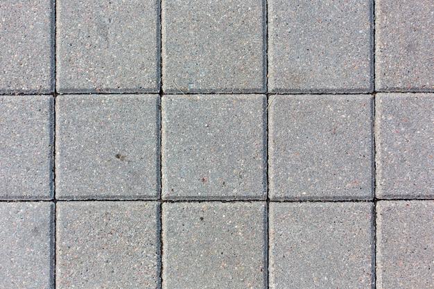 コンクリートの正方形のタイルテクスチャ背景