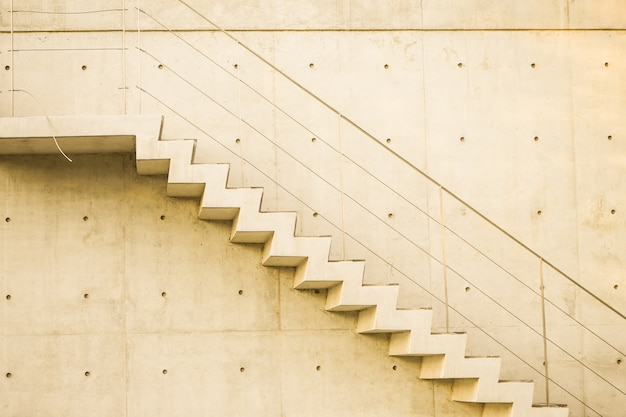 Concrete staircase with concrete wall out of building architecture conceptual idea