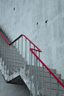 Concrete stairs with a red handrail