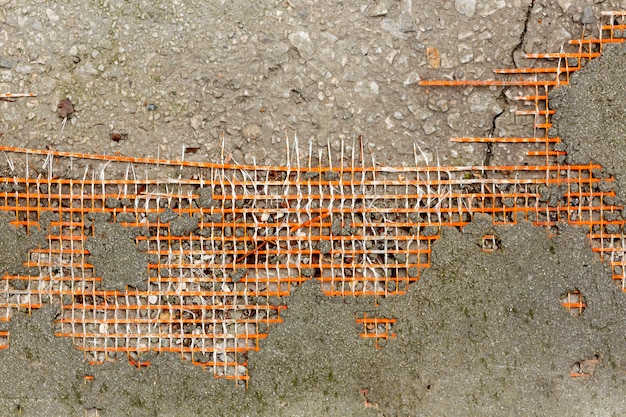 Concrete surface with mesh and rocks