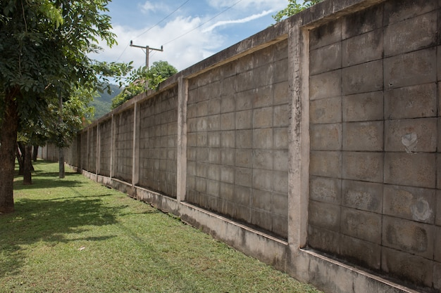 Concrete texture wall board fence panels in perspective view with green grass