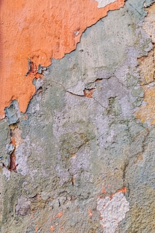 Concrete textured wall with peeling off paint.