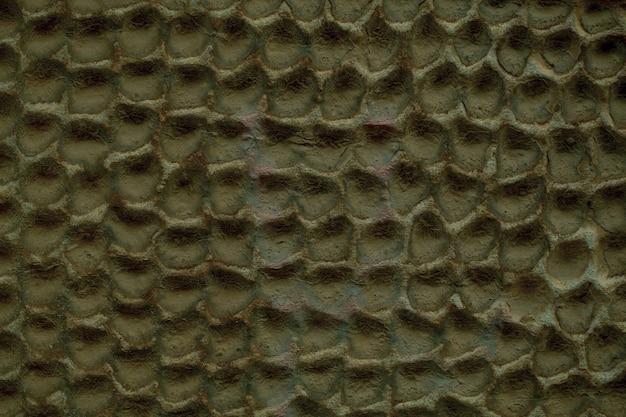 콘크리트 벽 추상 벌집 패턴 및 질감 무딘 거무스름한 페인트