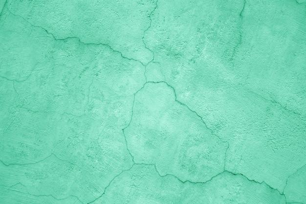 緑色に塗られたコンクリートの壁、テクスチャ石膏のクローズアップ