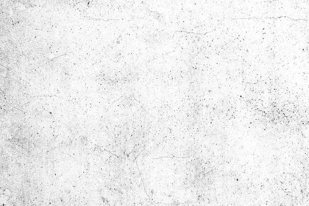 コンクリートの壁のテクスチャの背景。傷やひび割れのある壁の破片