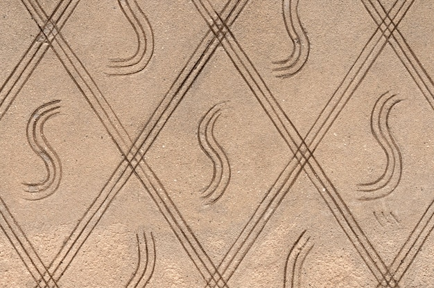 Concrete wall texture with ornament. stone surface background.