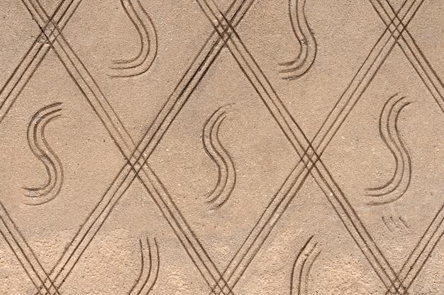 Текстура бетонной стены с орнаментом. каменная поверхность фона.